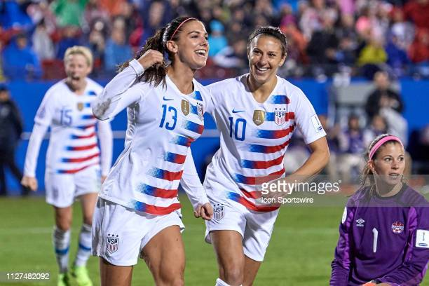 USA forward Alex Morgan celebrates with USA forward Carli Lloyd and teammates after scoring a goal during the final match of the CONCACAF Women's...