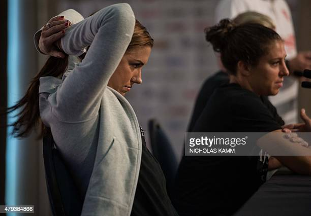 US forward Alex Morgan fixes her hair during a press conference with teammate Carli Lloyd in Vancouver on July 3 two days before the 2015 FIFA...