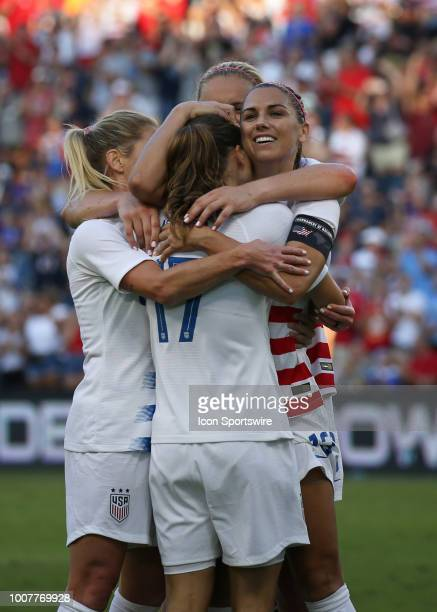 USA forward Alex Morgan gives Tobin Heath a hug after Heath assisted Morgan for a hat trick in the second half of a women's soccer match between...