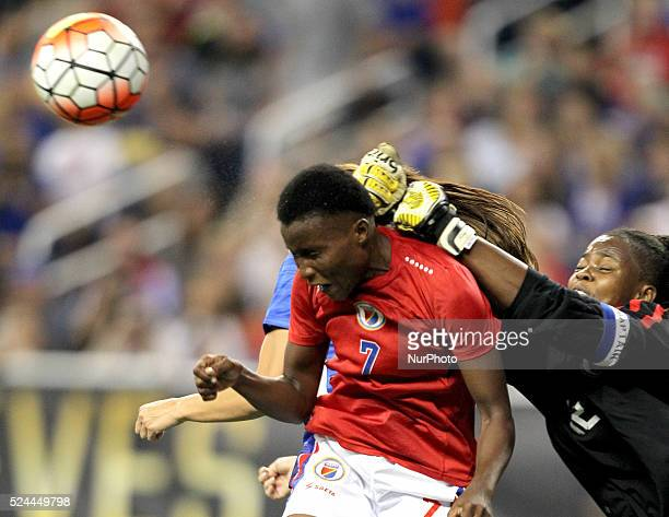 US forward Alex Morgan goes for header against Haiti's defender Roselord Borgella as the goalkeeper Edny Limage reaches to stop the ball during the...
