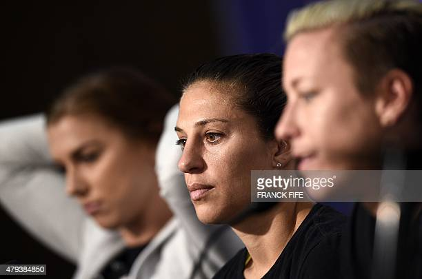 USA forward Alex Morgan midfielder Carli Lloyd and forward Abby Wambach give a press conference in Vancouver on July 3 2015 two days ahead of 2015...