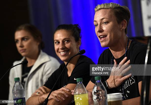 USA forward Alex Morgan midfielder Carli Lloyd and forward Abby Wambach give a press conference in Vancouver on July 3 two days ahead of 2015 FIFA...