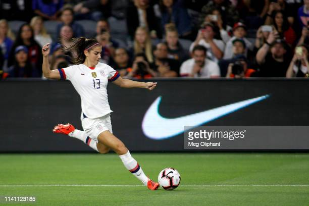 Forward Alex Morgan of the United States Women's National Team kicks the ball in the game against the Belgium Women's National Team at Banc of...