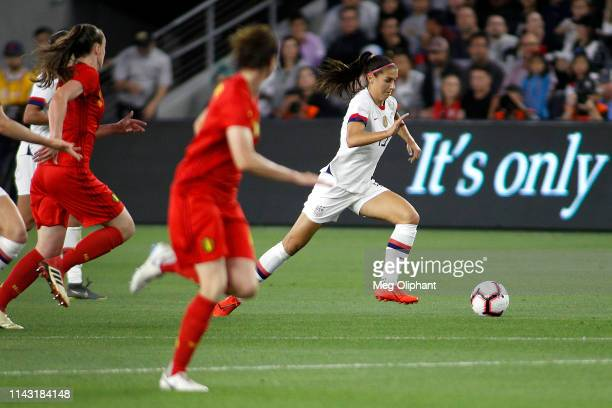 Forward Alex Morgan of the United States Women's National Team moves the ball in the game against Belgium at Banc of California Stadium on April 07...