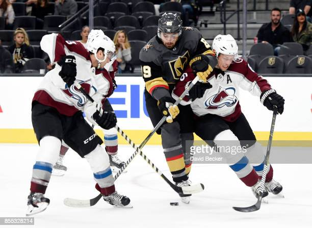 Forward Alex Tuch of the Vegas Golden Knights is doubleteamed by forward Alexander Kerfoot and Nikita Zadorov of the Colorado Avalanche during a...