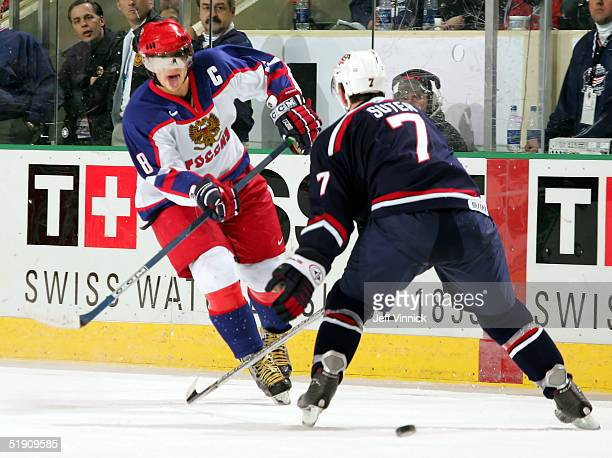 Forward Alexander Ovechkin of Russia shoots the puck through the legs of defenseman Ryan Suter of Team USA to score an empty net goal during the...