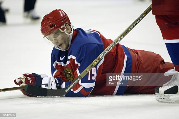 Forward Alexei Yashin of Russia falls to the ice against Belarus during the Salt Lake City Winter Olympic Games on February 15 2002 at the E Center...
