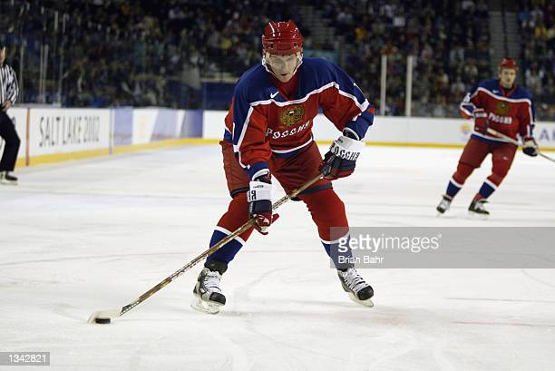 Forward Alexei Yashin of Russia skates with the puck against Belarus during the Salt Lake City Winter Olympic Games on February 15 2002 at the E...