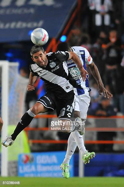 Forward Alvaro Navarro of Puebla jumps for the ball with defender Oscar Murillo of Pachuca during their Mexican Clausura 2016 Tournament football...