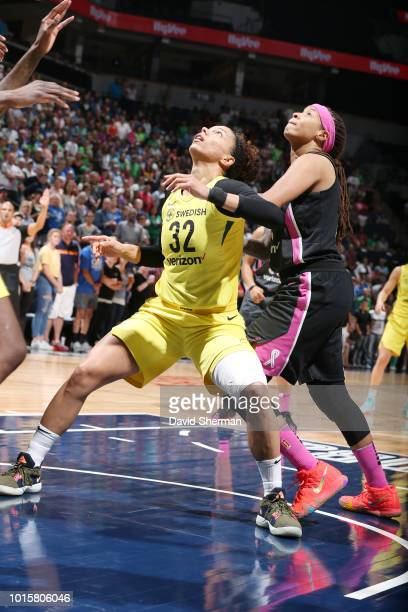 Forward Alysha Clark of the Seattle Storm jocks for a position during the game against guard Seimone Augustus of the Minnesota Lynx on August 12 2018...