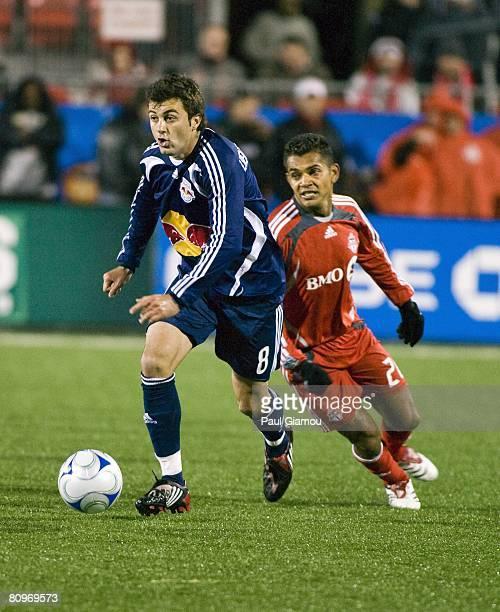 Forward Amado Guevara of the Toronto FC chases Sinisa Ubiparipovic of the New York Red Bulls on May 1, 2008 at BMO Field in Toronto, Canada
