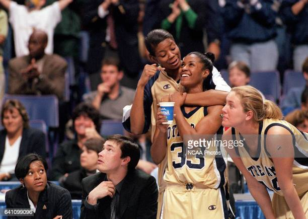 Forward Amanda Barksdale of Notre Dame celebrates with guard Niele Ivey after defeating the University of Connecticut during the Division 1 Women's...