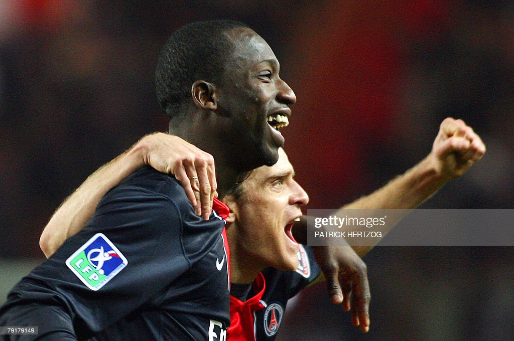 PSG forward Amara Diane (L) celebrates with teammate Jerome Rothen after scoring against FC Metz during their French L1 football match at the Parc des Princes in Paris, 23 January 2008.