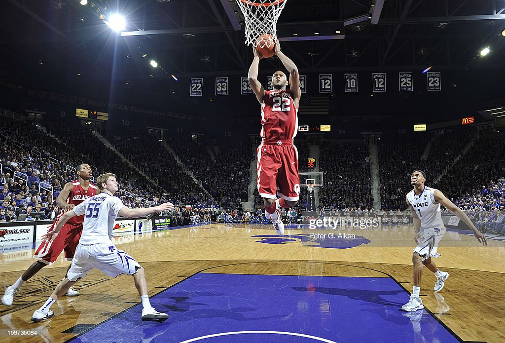 Forward Amath M'Baye #22 of the Oklahoma Sooners drives in for a basket against the Kansas State Wildcats during the second half on January 19, 2013 at Bramlage Coliseum in Manhattan, Kansas. Kansas State defeated Oklahoma 69-60.