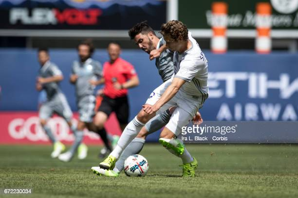 Forward and Captain David Villa of New York City FC gets locked in for a fight for control with Jonathan Spector of Orlando City SC during the MLS...