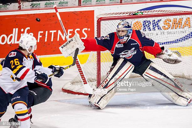 Forward Andrew Mangiapane of the Barrie Colts fires the puck just wide of the net against goaltender Mario Culina of the Windsor Spitfires on...