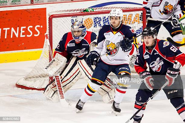 Forward Andrew Mangiapane of the Barrie Colts skates against goaltender Mario Culina of the Windsor Spitfires on February 25, 2016 at the WFCU Centre...