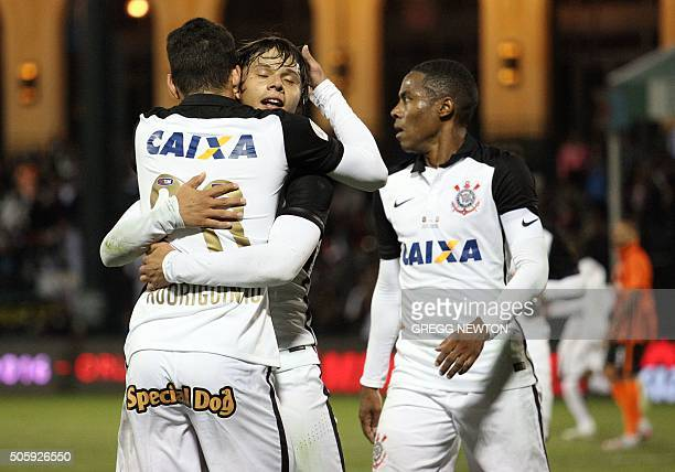 Forward Angel Romero the of Brazilian club SC Corinthians is congratulated by teammates Rodriguinho and Elias after scoring his second goal of the...