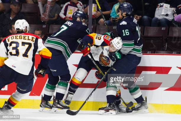 Forward Anthony Cirelli of the Erie Otters battles against forward Alexander True and Tyler Adams of the Seattle Thunderbirds on May 20 2017 during...