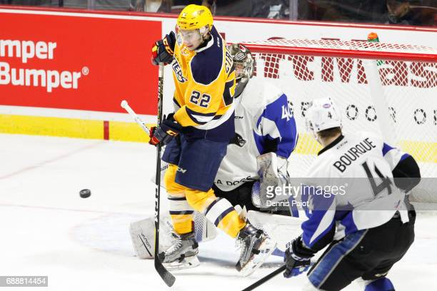 Forward Anthony Cirelli of the Erie Otters deflects the puck against goaltender Callum Booth of the Saint John Sea Dogs on May 26 2017 during the...