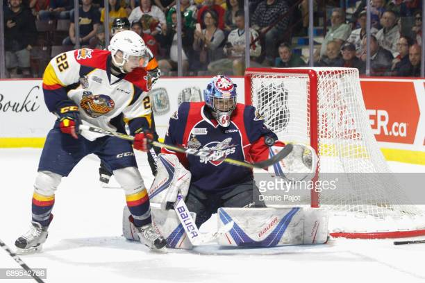 Forward Anthony Cirelli of the Erie Otters deflects the puck against goaltender Michael DiPietro of the Windsor Spitfires on May 28 2017 during the...