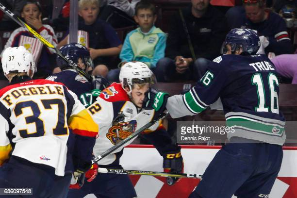 Forward Anthony Cirelli of the Erie Otters receives a glove to the face from forward Alexander True of the Seattle Thunderbirds on May 20 2017 during...