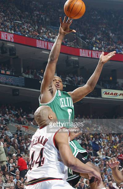 Forward Antoine Walker of the Boston Celtics shoots over forward Derrick Coleman of the Philadelphia 76ers during game 4 of the Eastern Conference...