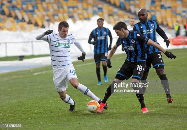 Forward Artem Besedin of FC Dynamo Kyiv is seen in action with defender Federico Ricca and midfielder Eder Balanta of Club Brugge KV during the UEFA...