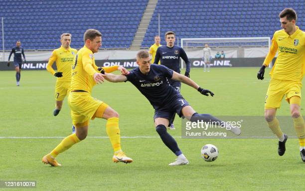 Forward Artem Dovbyk of SC Dnipro-1 and defender Kaspars Dubra FC Oleksandriia are seen in action during the Ukrainian Premier League Matchday 17...