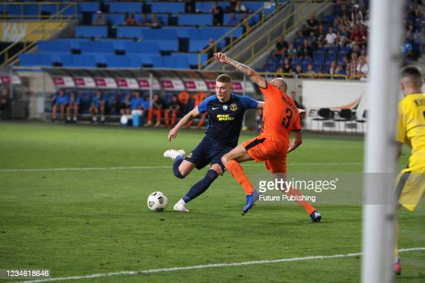 Forward Artem Dovbyk of SC Dnipro-1 and defender Stanislav Mykytsei of FC Mariupol are seen in action during the 2021/2022 Ukrainian Premier League...