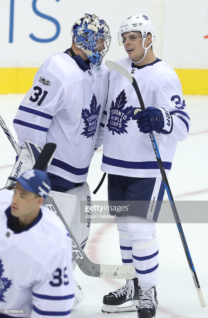 Forward Auston Matthews #34 of the Toronto Maple Leafs congratulates goaltender Frederik Andersen #31 after defeating the Winnipeg Jets during NHL action on October 4, 2017 at the Bell MTS Place in Winnipeg, Manitoba.
