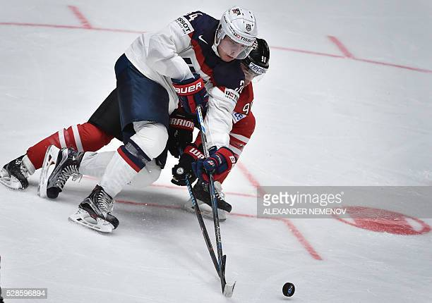 US forward Auston Matthews vies with Canada's forward Ryan O'Reilly during the group B preliminary round game USA vs Canada at the 2016 IIHF Ice...