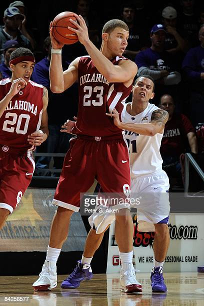 Forward Blake Griffin of the Oklahoma Sooners gets pressure from behind from guard Denis Clemente of the Kansas State Wildcats during the second half...