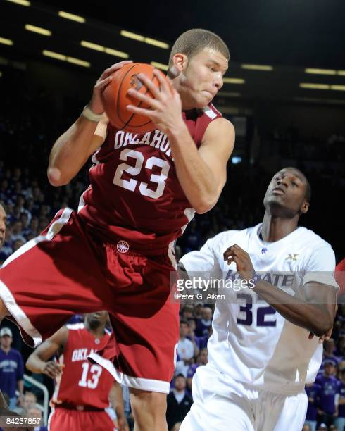 Forward Blake Griffin of the Oklahoma Sooners pulls down a defensive rebound past forward Jamar Samuels of the Kansas State Wildcats during the first...