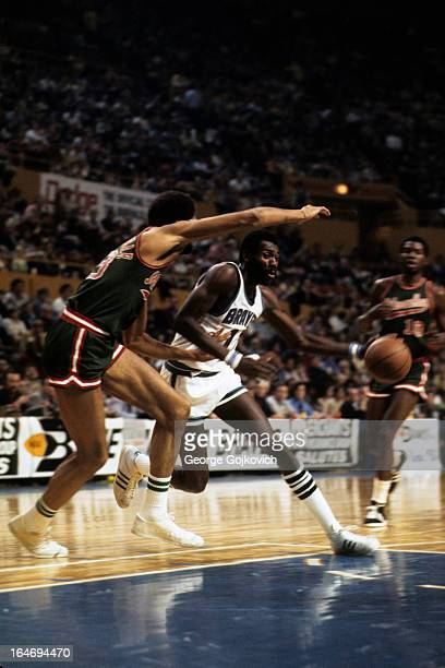 Forward Bob McAdoo of the Buffalo Braves drives to the basket against center Kareem AbdulJabbar of the Milwaukee Bucks during a National Basketball...