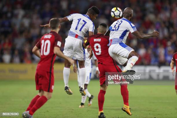 USA forward Bobby Wood attempts a header between 2 Panama players during the World Cup Qualifying soccer match between the US Mens National Team and...