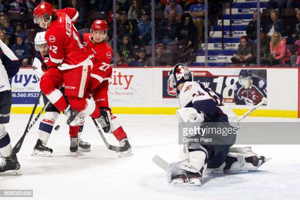 Forward Boris Katchouk of the Sault Ste Marie Greyhounds deflects the puck against goaltender Michael DiPietro of the Windsor Spitfires on October 5...