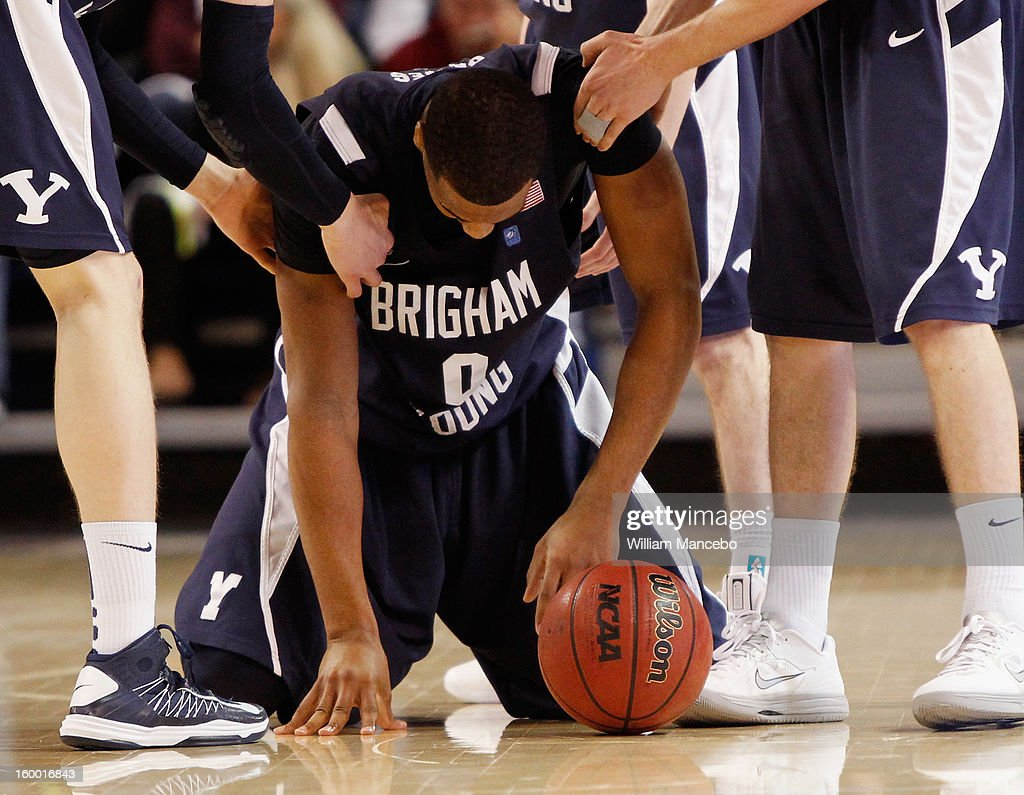 Forward Brandon Davies #0 of the BYU Cougars falls to the floor during the second half of the game against the Gonzaga Bulldogs at McCarthey Athletic Center on January 24, 2013 in Spokane, Washington.