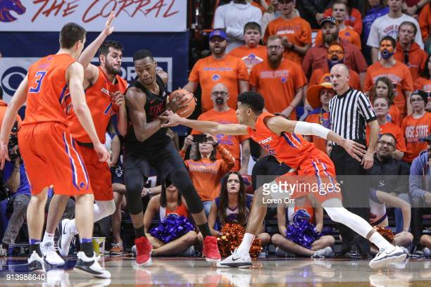 Forward Brandon McCoy of the UNLV Rebels finds himself surrounded by forward Zach Haney and guard Chandler Hutchison of the Boise State Broncos...