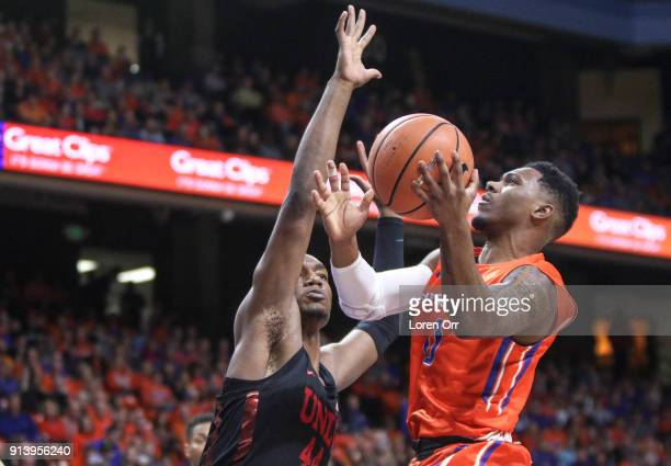Forward Brandon McCoy of the UNLV Rebels tries to block the shot of guard Marcus Dickinson of the Boise State Broncos during first half action on...