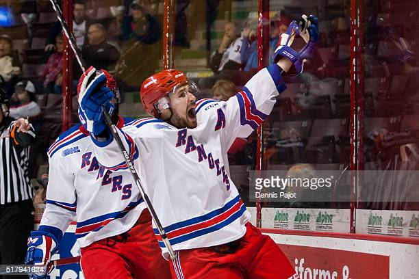 Forward Brandon Robinson of the Kitchener Rangers celebrates the gamewinning goal against the Windsor Spitfires during game 3 of the Western...