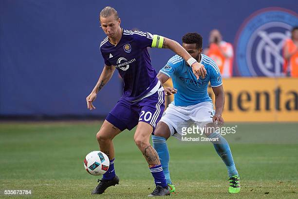 Forward Brek Shea of Orlando City FC keeps the ball from defender Ethan White of New York City FC during the match at Yankee Stadium on May 29 2016...