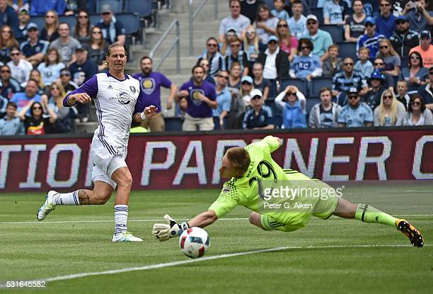 Forward Brek Shea of Orlando City SC takes a shot on goal against goalkeeper Tim Melia of Sporting Kansas City during the first half on May 15 2016...