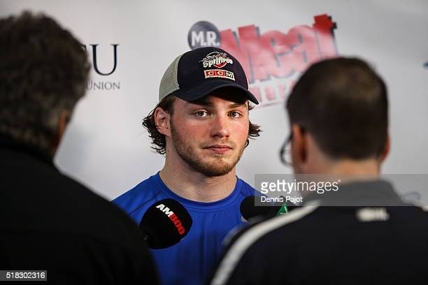 Forward Brendan Lemieux of the Windsor Spitfires speaks to the media after a 54 overtime win over the Kitchener Rangers during game 4 of the Western...
