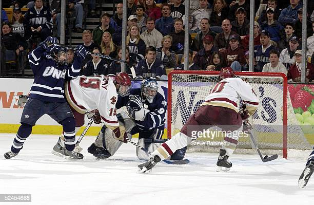 Forward Brian Boyle of the Boston College Eagles scores against goalie Jeff Pietrasiak of the University of New Hampshire Wildcats during the second...