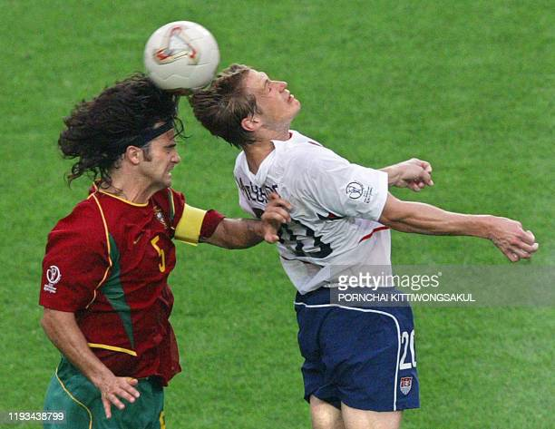 US forward Brian McBride tries for a header with Portuguese defender Fernando Couto in their Group D match at the 2002 FIFA World Cup Korea/Japan in...
