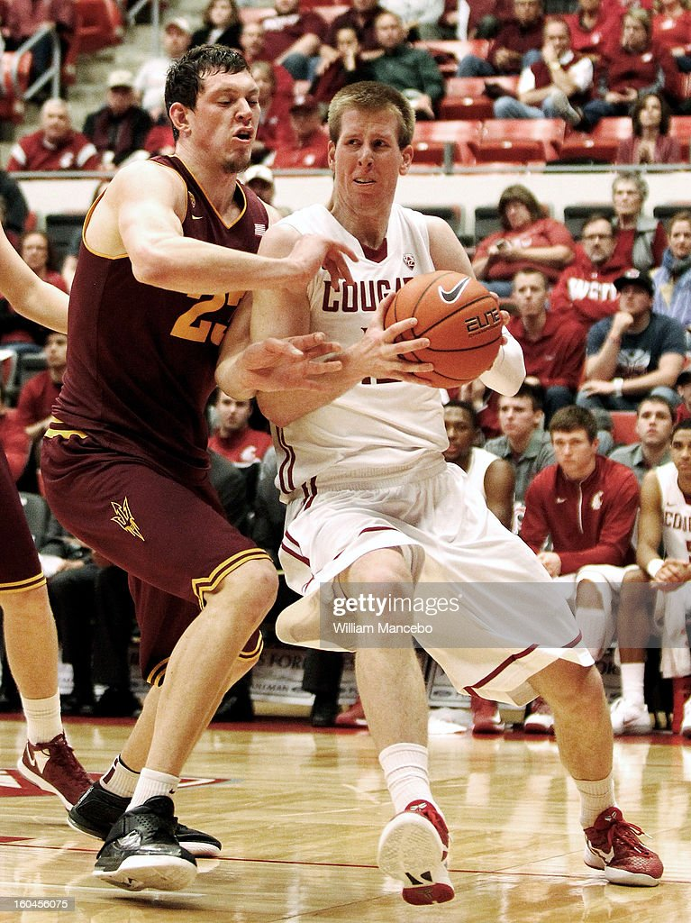 Forward Brock Motum #12 of the Washington State Cougars plays against center Ruslan Pateev #23 of the Arizona State Sun Devils during the second half of the game at Beasley Coliseum on January 31, 2013 in Pullman, Washington.