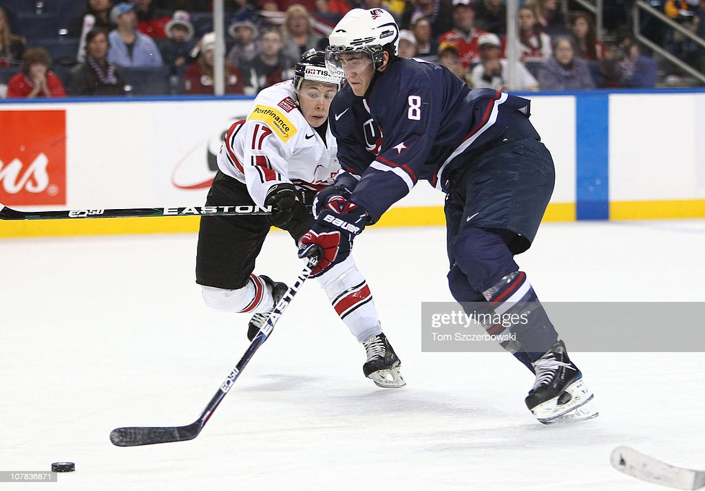 Forward Brock Nelson #8 of USA skates past defenseman Dario Trutmann #17 during the 2011 IIHF World U20 Championship game between USA and Switzerland on December 31, 2010 at HSBC Arena in Buffalo, New York.