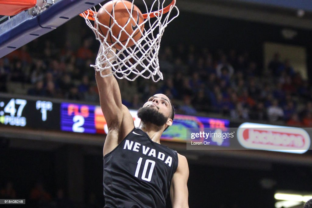 Forward Caleb Martin #10 of the Nevada Wolf Pack dunks the ball for two points during first-half action against the Boise State Broncos on February 14, 2018 at Taco Bell Arena in Boise, Idaho.