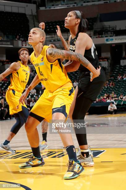 Forward Candice Dupree of the Indiana Fever and center A'ja Wilson of the Las Vegas Aces look to retrieve a rebound during the game on June 12 2018...